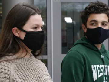 While wearing protective masks due to the COVID-19 outbreak, Lucy Vitali, who portrays Juliet, left, stands with Alex Mansour, who portrays Romeo, outside the auditorium after working on their virtual performance of Shakespeare