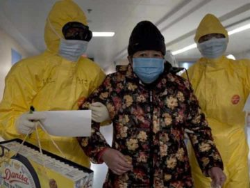 A still from the documentary 76 Days showing medical workers limiting the number of patients admitted into a hospital during the peak of the COVID-19 outbreak in Wuhan, China. (Credit: Courtesy 76 Days LLC)