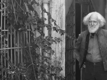 """Mehrotra at the gate of his home in Dehradun. """"My sense of mortality is keener than ever,"""" he says. """"In my garden, I look at an unfamiliar sapling and wonder if I'll ever find out its name."""""""